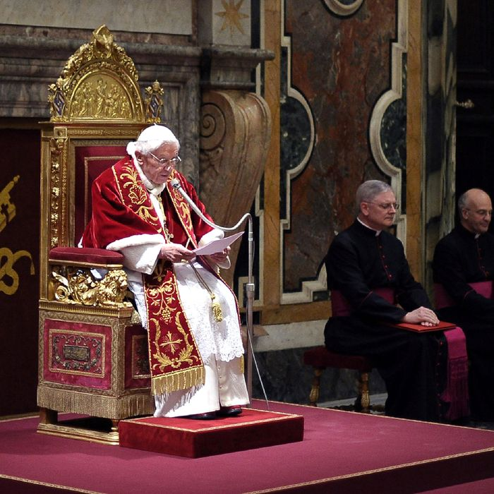 Pope Benedict XVI speaks to his cardinals during a farewell ceremony in the Clementine Hall of the Vatican's Apostolic Palace on February 28, 2013 in Vatican City, Vatican. Pope Benedict XVI will acquire the title 'Pope Emeritus' as he retires the pontificate today, and will travel to a papal retreat at Castel Gandolfo, near Rome