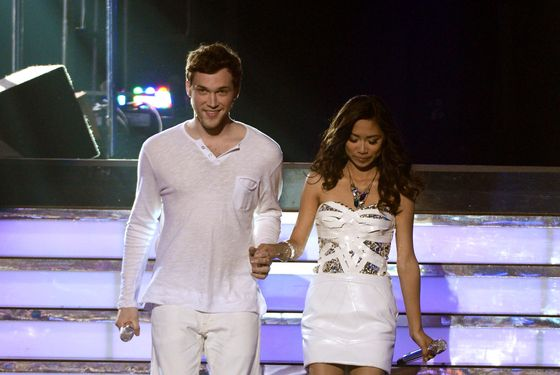 "LOS ANGELES, CA - MAY 23:  Finalists Phillip Phillips and Jessica Sanchez walk onstage during Fox's ""American Idol 2012"" results show at Nokia Theatre L.A. Live on May 23, 2012 in Los Angeles, California.  (Photo by Mark Davis/Getty Images)"