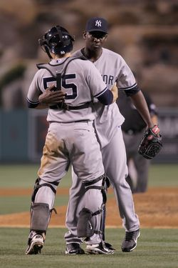 ANAHEIM, CA - MAY 30:  Catcher Russell Martin #55 of the New York Yankees and closing pitcher Rafael Soriano #29 celebrate their teams 6-5 victory over the Los Angeles Angels of Anaheim at Angel Stadium of Anaheim on May 30, 2012 in Anaheim, California.  (Photo by Jeff Gross/Getty Images)