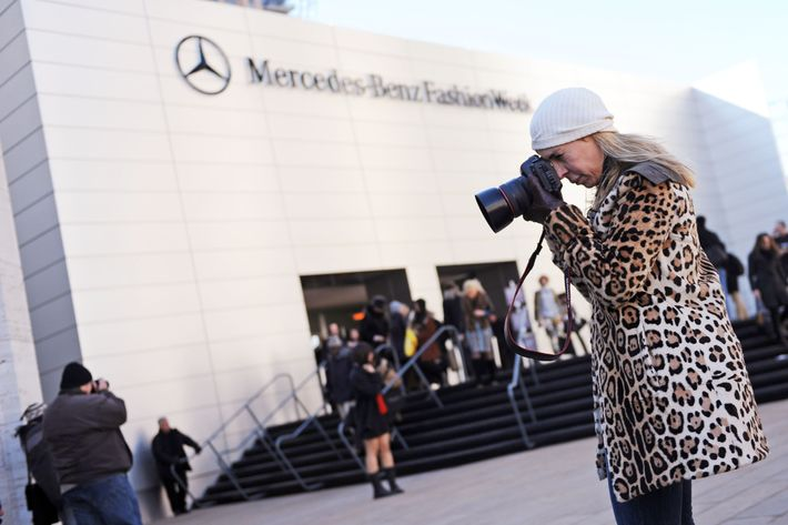 A photographer outside the Lincoln Center tents.