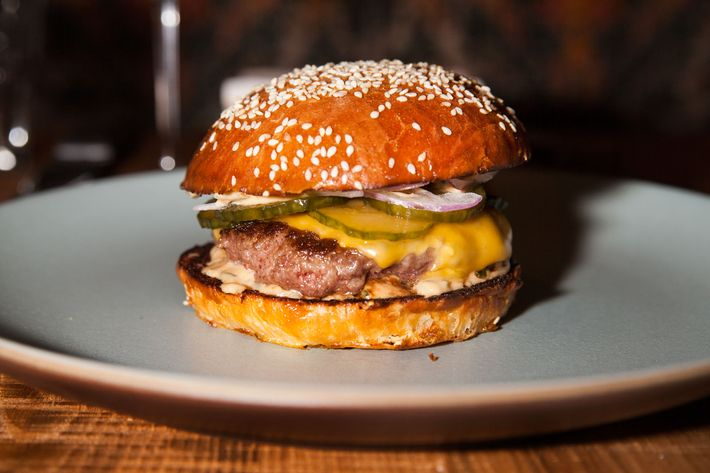 The burger is made from a mix of chuck and wagyu flap meat and served on a housemade bun with American cheese, pickles, and special sauce.