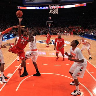 NEW YORK, NY - MARCH 10: Malik Stith #31 of the St. John's Red Storm drives to the basket against James Southerland #43 and Rick Jackson #00 of the Syracuse Orange during the quarterfinals of the 2011 Big East Men's Basketball Tournament presented by American Eagle Outfitters at Madison Square Garden on March 10, 2011 in New York City. (Photo by Chris Trotman/Getty Images) *** Local Caption *** Malik Stith;James Southerland;Rick Jackson