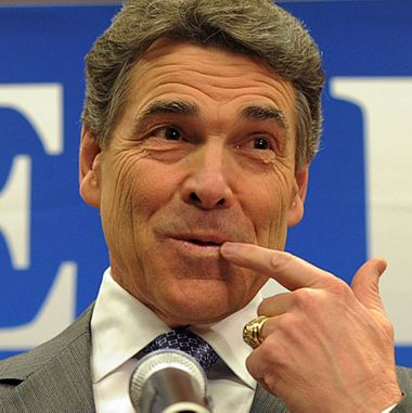 19 Jan 2012, North Charleston, South Carolina, USA --- epa03067569 Texas Governor and US Republican presidential candidate Rick Perry (C) with his wife Anita (R) and his son Griffin announces that he is pulling out of the Republican presidential race at a press conference in North Charleston, South Carolina, USA, 19 January 2012. Perry endorsed Newt Gingrich. The South Carolina Republican presidential primary is 21 January 2012. EPA/ERIK S. LESSER --- Image by ? ERIK S. LESSER/epa/Corbis