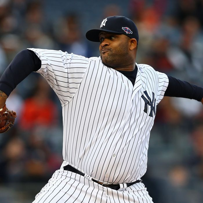 NEW YORK, NY - OCTOBER 12: CC Sabathia #52 of the New York Yankees pitches in the first inning against the Baltimore Orioles during Game Five of the American League Division Series at Yankee Stadium on October 12, 2012 in New York, New York. (Photo by Elsa/Getty Images)