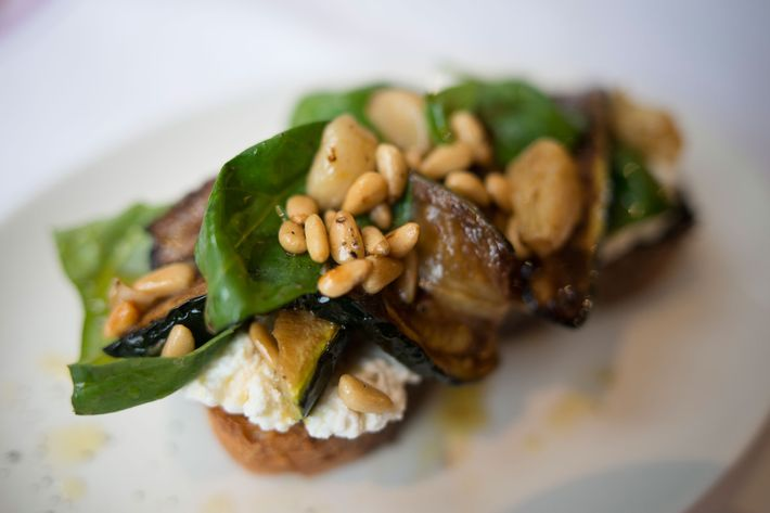Bruschetta with zucchini, ricotta, and pine nuts.