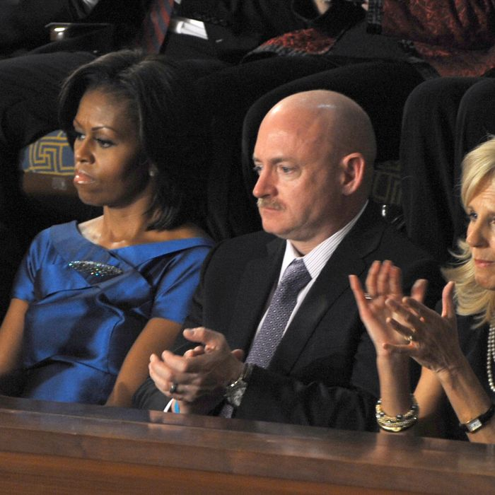 24 Jan 2012, Washington, DC, USA --- President Barack addresses Congress during his annual State of the Union Address. Captian Mark Kelly husband of Cong, Gabrielle Giffords sits in the First Lady's Box between First Lady Michelle Obama and Dr. Jill Biden.
