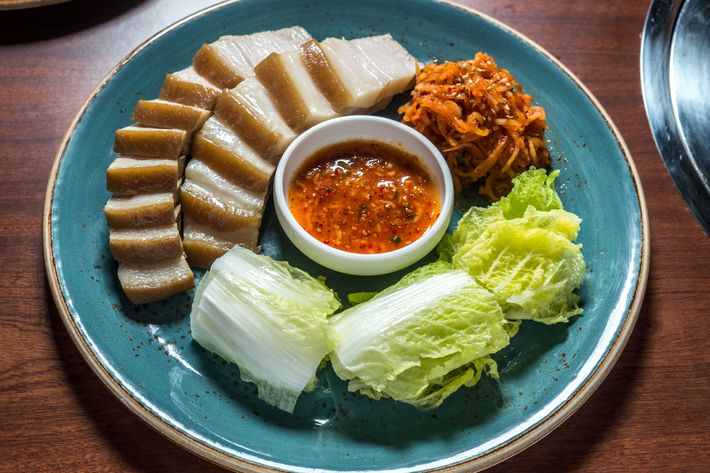 The bossam, or pork belly, boiled in spices and thinly sliced, with its accouterments.