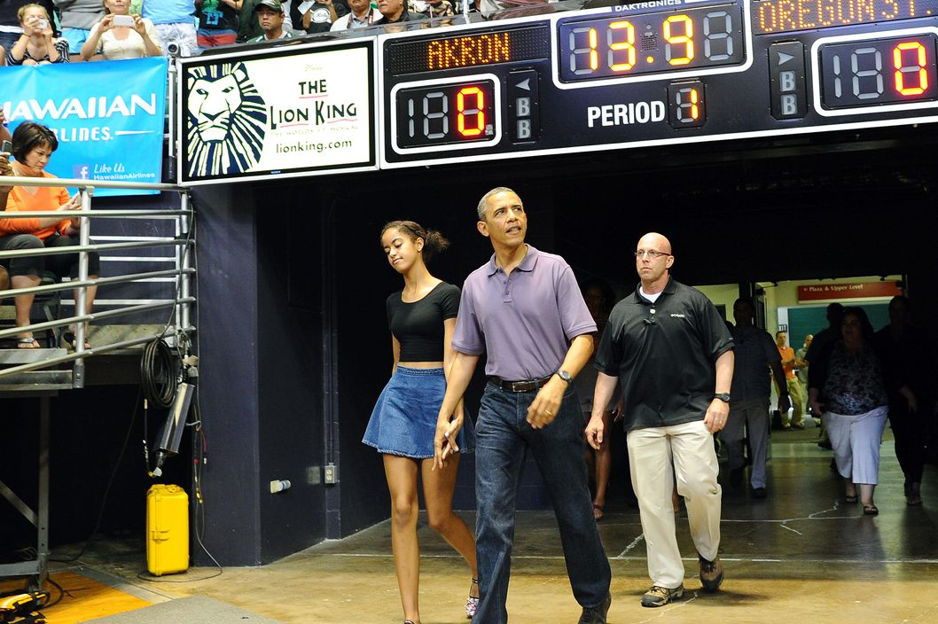 US President Barack Obama and dauther Malia arrive to watch the Oregon State University vs University of Akron college basketball game at the Diamond Head Classic at the Stan Sheriff Center in Honolulu, Hawaii, on December 22, 2013. Michelle Obama's bother, Craig Robinson, is the coach of Oregon State. The first family is in Hawaii for their annual winter holiday vacation.   AFP PHOTO/Jewel SAMAD        (Photo credit should read JEWEL SAMAD/AFP/Getty Images)