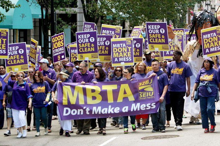 BOSTON - JUNE 21: Service Employees International Union members march in support of MBTA contracted janitors who may loose their jobs because of MBTA cutbacks on Boylston St. in Boston, Mass. on June 21, 2014. (Photo by John Blanding/The Boston Globe via Getty Images)