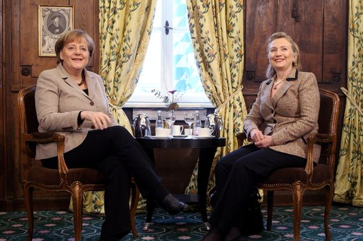 MUNICH, GERMANY - FEBRUARY 05:  US Secretary of State Hillary Clinton (R) and German Chancellor Angela Merkel speak during the second day of the 47th Munich Security Conference at Hotel Bayerischer Hof on February 5, 2011 in Munich, Germany. The 47th Munich conference on security policy is running till February 6, 2011.  (Photo by Miguel Villagran/Getty Images) *** Local Caption *** Angela Merkel;Hillary Clinton