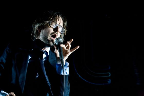 NEW YORK, NY - APRIL 10: Jarvis Cocker of Pulp performs on stage at Radio City Music Hall on April 10, 2012 in New York, United States. (Photo by Wendy Redfern/Redferns via Getty Images)