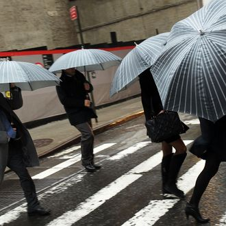 Pedestrians battle wind and rain in New York City