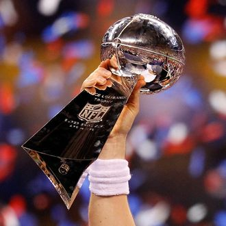 Quarterback Eli Manning #10 of the New York Giants poses with the Vince Lombardi Trophy after the Giants defeated the Patriots by a score of 21-17 in Super Bowl XLVI at Lucas Oil Stadium on February 5, 2012 in Indianapolis, Indiana.