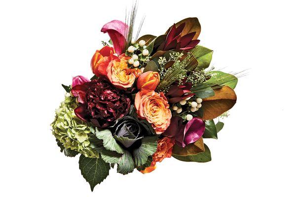Eucalyptus, hydrangea, leucadendron, magnolia branch, Peach Finesse rose, kale, mini raspberry calla lily, tulip, and white hypericum