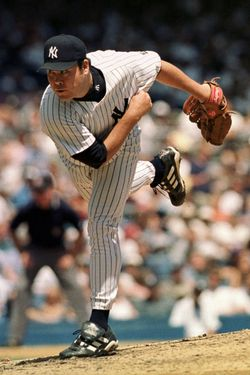 NEW YORK, UNITED STATES:  New York Yankees pitcher Hideki Irabu follows through on a pitch during game against the Toronto Blue Jays 04 August 1999 in Yankee Stadium. Irabu got the victory as he pitched seven innings, giving up three runs on seven hits with eight strike outs as the Yankees won, 8-3.   AFP PHOTO  Stan HONDA (Photo credit should read STAN HONDA/AFP/Getty Images)