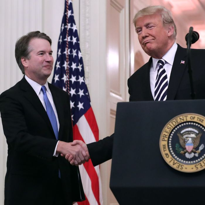 U.S. Supreme Court Justice Brett Kavanaugh (L) shakes hands with President Donald Trump during Kavanaugh's ceremonial swearing in in the East Room of the White House October 08, 2018 in Washington, DC.