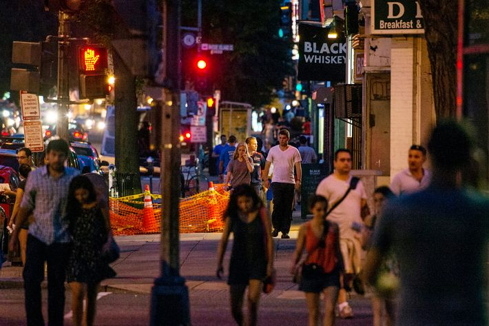 Pedestrians walk up 14th Street NW near Rhode Island Ave. on July 17, 2013 in Washington, D.C.