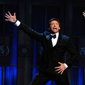 NEW YORK, NY - JUNE 12: Hugh Jackman (L) and Neil Patrick Harris perform on stage during the 65th Annual Tony Awards at the Beacon Theatre on June 12, 2011 in New York City. (Photo by Andrew H. Walker/Getty Images)