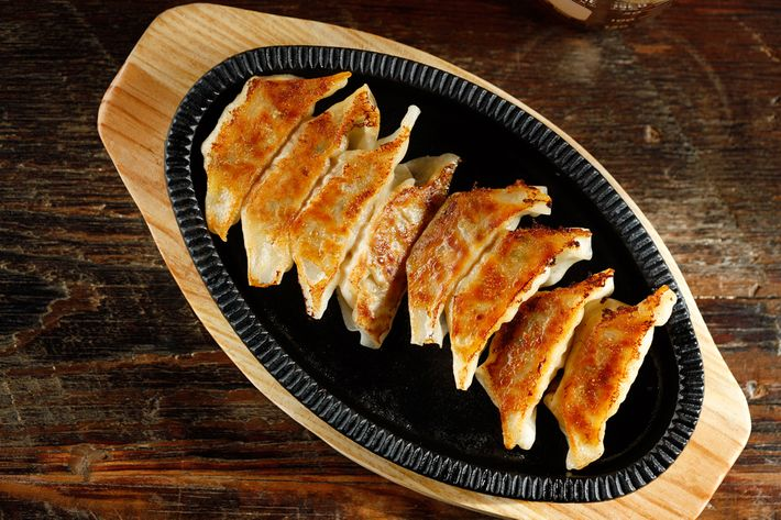 The teppan gyoza (pork, cabbage, and ginger) come out sizzling.
