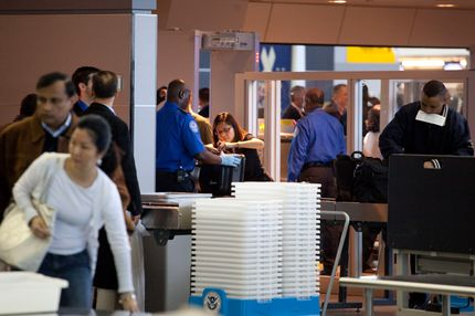Passengers pass through the passenger security checkpoint at John F. Kennedy International Airport's Terminal 8 on October 22, 2010 in the Queens borough of New York City.  Earlier today at Terminal 8, the TSA introduced new backscatter X-ray full-body scanners that can see through clothing and will screen passengers for metallic and non-metallic threats including explosives.