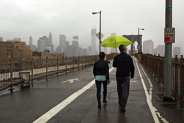 NEW YORK, NY - OCTOBER 30:  People walk on the Brooklyn Bridge which remains closed to traffic after the city awakens to the affects of Hurricane Sandy on October 30, 2012 in New York, United States. The storm has claimed at least 16 lives in the United States, and has caused massive flooding across much of the Atlantic seaboard. US President Barack Obama has declared the situation a 'major disaster' for large areas of the US East Coast including New York City.  (Photo by Spencer Platt/Getty Images)