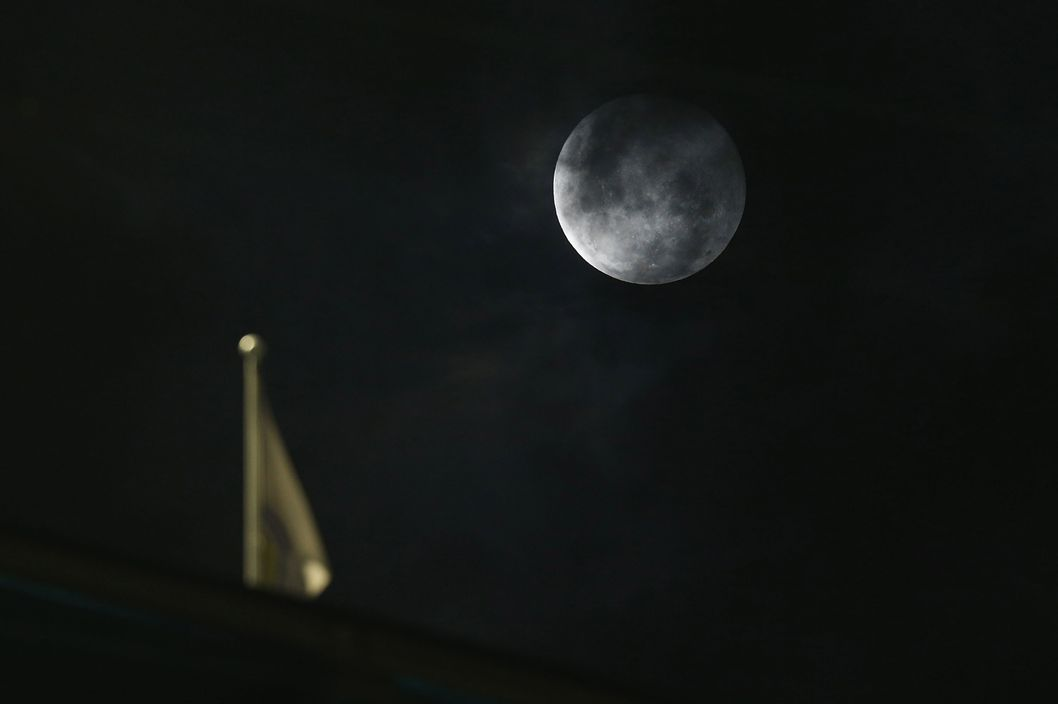 A full moon is seen during the round 13 AFL match between the Carlton Blues and the Hawthorn Hawks at Melbourne Cricket Ground on June 13, 2014 in Melbourne, Australia.