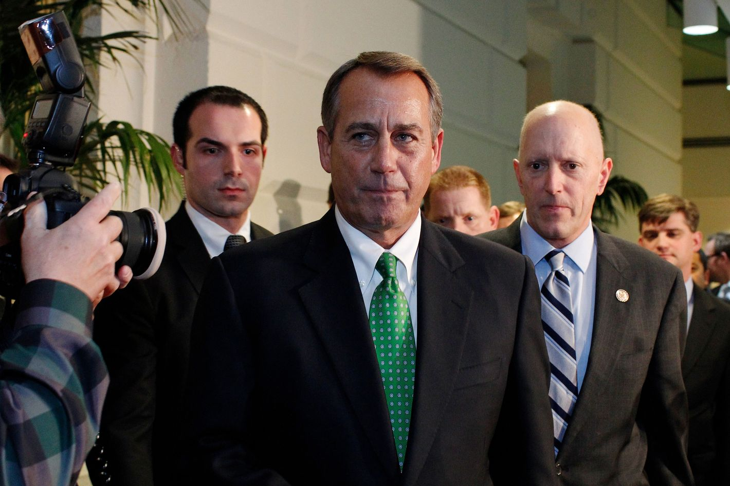 House Speaker John Boehner (R-OH) walks out after a second meeting with House Republicans at the US Capitol on January 1, 2013 in Washington, DC. Lawmakers are under pressure to pass at least some form of fiscal cliff crisis legislation before financial markets open on Wednesday, but it was increasingly unclear whether that could be done.