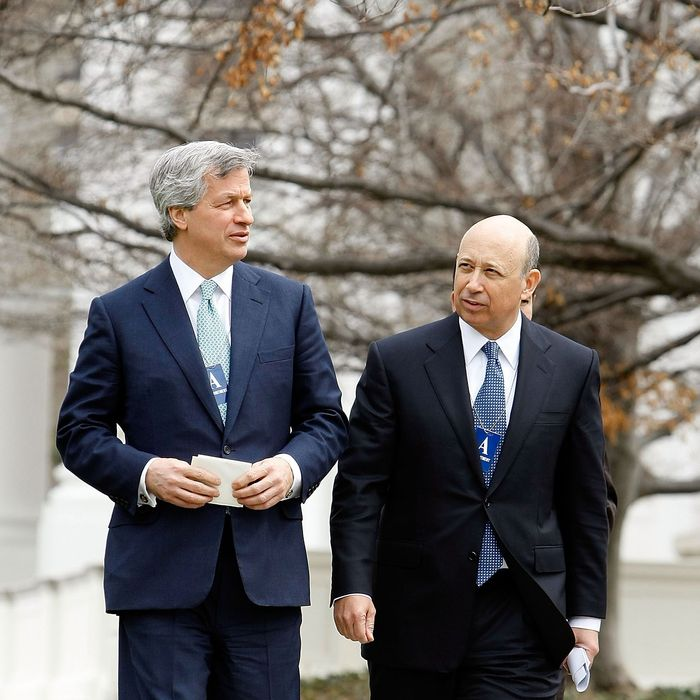 JP Morgan Chase CEO Jamie Dimon (L) and Goldman Sachs CEO Lloyd Blankfein leave the White House after they and 13 other bank heads met with President Barack Obama March 27, 2009 in Washington, DC. Obama used the meeting to tell the bankers that they must look beyond short-term interests toward obligations each person has in order to make it through the current economic troubles.