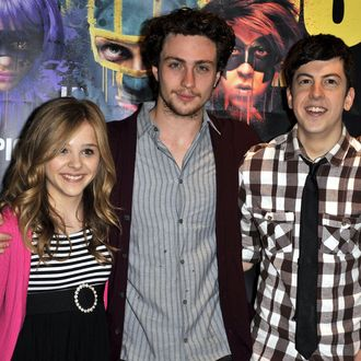 HOLLYWOOD - APRIL 12: Chloe Moretz, Christopher Mintz-Plasse and Aaron Johnson pose for a picture at the 'Kick Ass' cast meet and greet fan event held at Hot Topic on April 12, 2010 in Hollywood, California. (Photo by Toby Canham/Getty Images) *** Local Caption *** Chloe Moretz;Christopher Mintz-Plasse;Aaronn Johnson