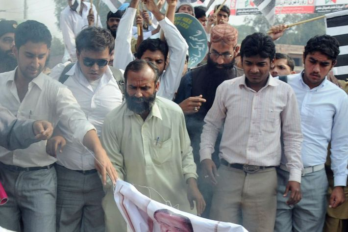 Supporters of Pakistan's outlawed Islamic hardliner Jamaat ud Dawa (JD) burn an effigy of the US President Barack Obama, NATO and US flags during a protest in Multan on November 28, 2011, against a NATO strike on Pakistan troops. Hundreds of Pakistanis called on Islamabad to break off its alliance with the United States and get out of the war on Al-Qaeda as protests against a lethal NATO strike pushed into a third day. Twenty-four Pakistani soldiers were killed in the cross-border attack early Saturday by NATO helicopters and fighter jets. AFP PHOTO / S.S MIRZA (Photo credit should read S.S MIRZA/AFP/Getty Images)