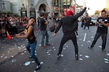"HOLLYWOOD, CA - JULY 27:  Riots break out at ""Electric Daisy Carnival Experience"" Los Angeles premiere held at Grauman's Chinese Theatre on July 27, 2011 in Hollywood, California.  (Photo by Imeh Akpanudosen/Getty Images)"