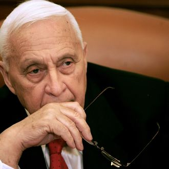 Israeli Prime Minister Ariel Sharon attends a ceremony completing the sale of Bank Leumi to a private US investment group at his office in Jerusalem 04 January 2006. Sharon was at the centre of fresh corruption allegations today, the first scandal to threaten the prospects for his new Kadima party ahead of March general elections. The premier has so far remained tight-lipped over police claims that they may have evidence to prove that the premier's family received a three million dollar bribe from an Austrian billionaire. Police believe some of the money was used by the family to pay back campaign contributions that were subsequently deemed illegal in Sharon's successful 1999 bid to become leader of the right-wing Likud party. AFP PHOTO/POOL/ELIANA APONTE (Photo credit should read ELIANA APONTE/AFP/Getty Images)