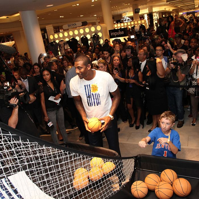 NEW YORK, NY - SEPTEMBER 08: NBA player Amar'e Stoudemire and a youngster shoot hoops to celebrate Fashion's Night Out at Macy's Herald Square on September 8, 2011 in New York City. (Photo by Taylor Hill/Getty Images for Macy's)