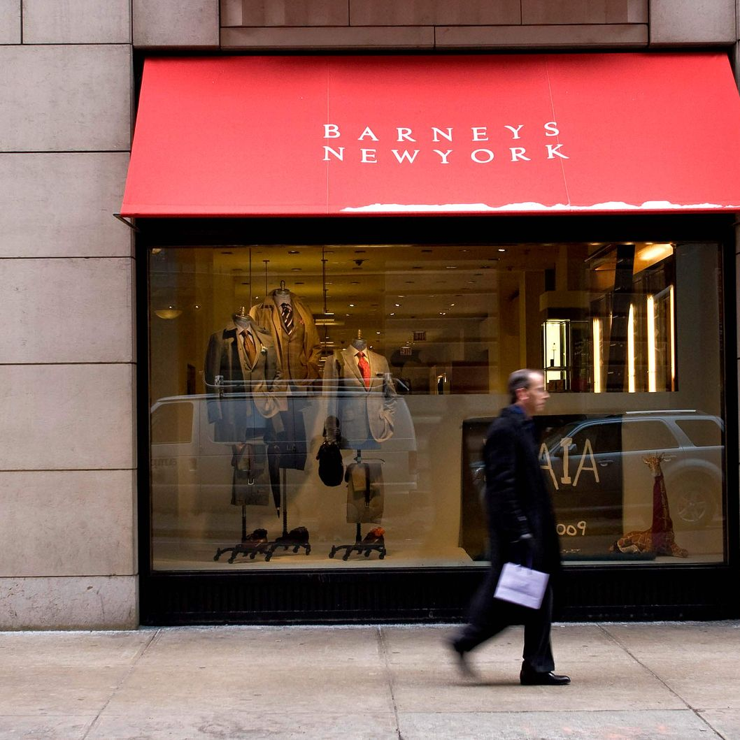 A pedestrian walks past a window display at Barneys New York department store in New York, U.S., on Thursday, Jan. 22, 2009.