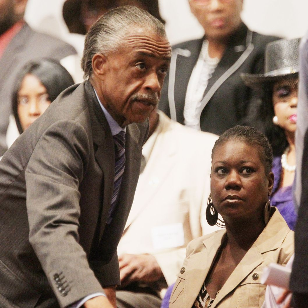 EATONVILLE, FL - MARCH 26:   Rev. Al Sharpton (C) and Sybrina Fulton (LOWER R), mother of slain teenager Trayvon Martin, attend a community forum on the killing of Trayvon Martin at Macedonia Baptist Church on March 26, 2012 in Eatonville, Florida. A march and rally are planned for later this afternoon in Sanford which will hold a town hall meeting on the incident at 5:00 p.m.   (Photo by Mario Tama/Getty Images)