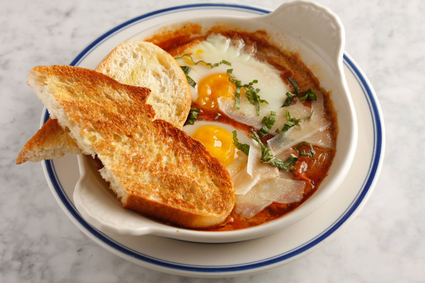 Baked eggs in housemade marinara sauce with basil and Parmesan.
