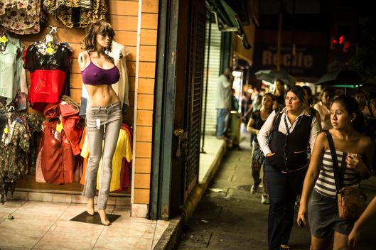 Mannequins with extreme proportions display clothes for sale at a store in Caracas, Venezuela, Oct. 30, 2013. Mannequins with extreme proportions  have become standard in stores throughout the country as Venezuelan women increasingly use plastic surgery to transform their bodies. (Meridith Kohut /The New York Times)