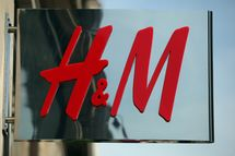 The Hennes & Mauritz AB (H&M) company logo hangs at a store in London, U.K.