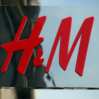 The Hennes & Mauritz AB (H&M) company logo hangs at a store in London, U.K., on Wednesday, June 23, 2010.