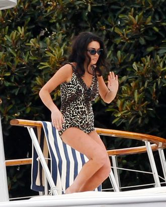 Lindsay Lohan bares all in a leopard print one-piece during filming for 'Liz & Dick'.