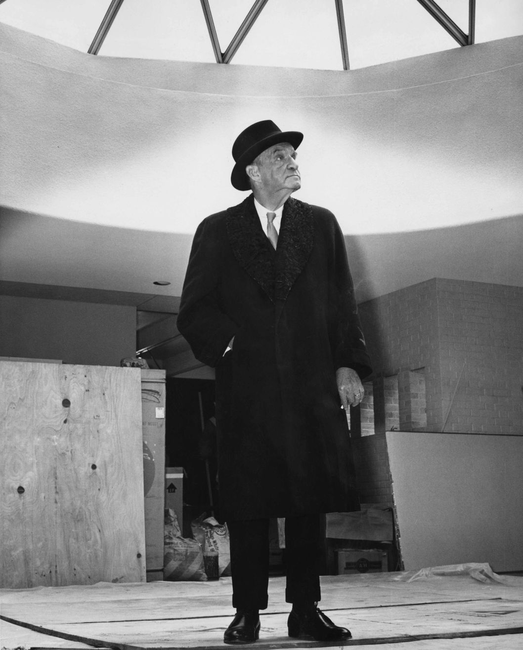 American architect Edward Durell Stone (1902 - 1978) stands in the atrium of the 'modern house' he has created for the New York World's Fair in Flushing Meadows, New York, 9th April 1964. The house is still under construction, only days before the opening of the fair. (Photo by Pictorial Parade/Archive Photos/Getty Images)
