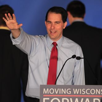 WAUKESHA, WI - JUNE 05: Wisconsin Governor Scott Walker greets supporters at an election-night rally June 5, 2012 in Waukesha, Wisconsin. Walker, only the third governor in history to face a recall election, defeated his Democrat contender Milwaukee Mayor Tom Barrett. Opponents of Walker forced the recall election after the governor pushed to change the collective bargaining process for public employees in the state. (Photo by Scott Olson/Getty Images)