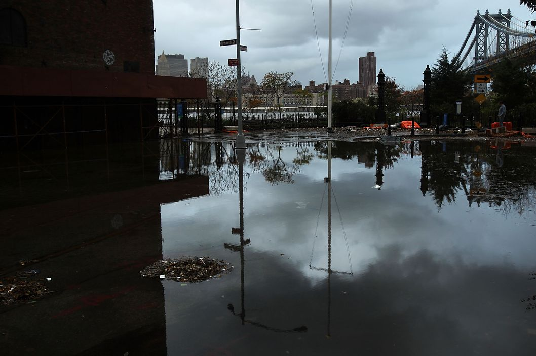 A flooded street in the Dumbo section of Brooklyn is viewed after the city awakens to the affects of Hurricane Sandy on October 30, 2012 in New York, United States. At least 15 people were reported killed in the United States by Sandy as millions of people in the eastern United States have awoken to widespread power outages, flooded homes and downed trees. New York City was his especially hard with wide spread power outages and significant flooding in parts of the city.