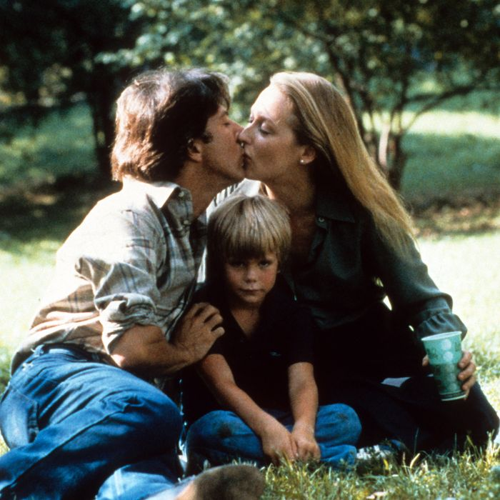 Dustin Hoffman kisses Meryl Streep in a scene from the film 'Kramer Vs. Kramer', 1979. (Photo by Columbia Pictures/Getty Images)
