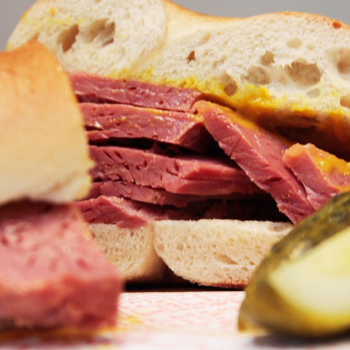 Salt beef, which is really corned beef, on a bagel with yellow deli mustard.