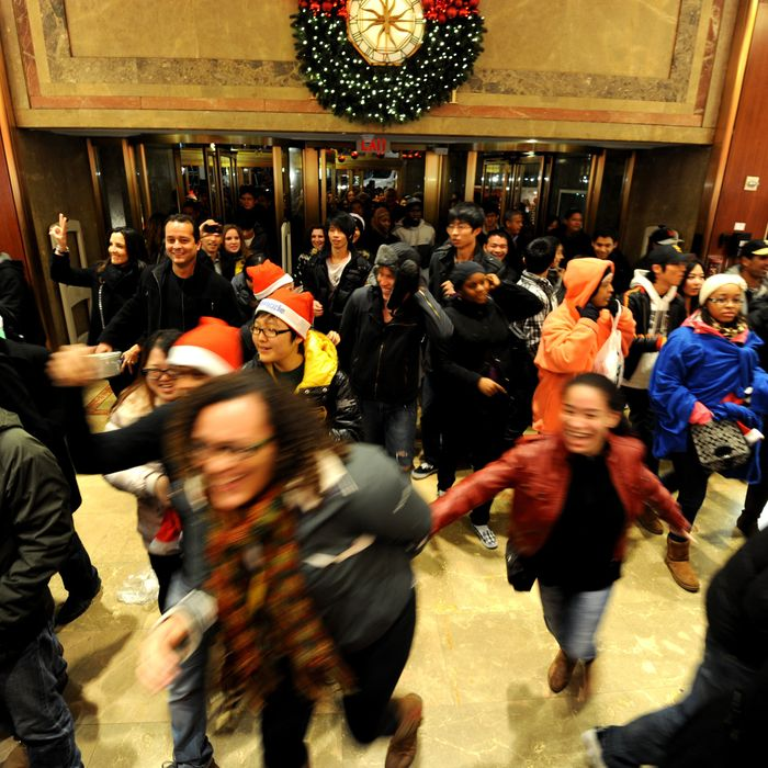 Oddly cheerful stampeding shoppers at Macy's on Black Friday.