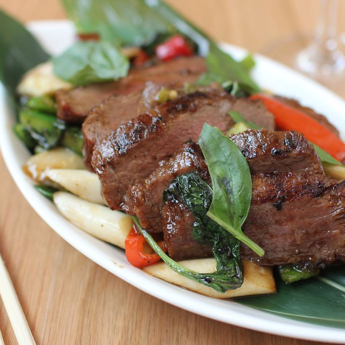 Grilled skirt steak sautéed with asparagus and leeks.