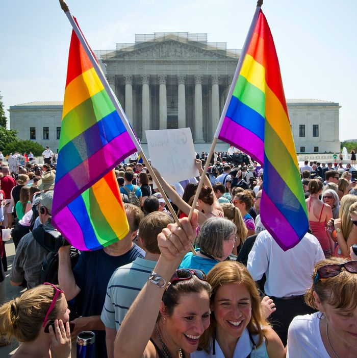 Hundreds of people gather outside the US Supreme Court building in Washington, DC on June 26, 2013 in anticipation of the ruling on California's Proposition 8, the controversial ballot initiative that defines marriage as between a man and a woman. The US Supreme Court on Wednesday struck down a controversial federal law that defines marriage as a union between a man and a woman, in a major victory for supporters of same-sex marriage.The Defense of Marriage Act (DOMA) had denied married gay and lesbian couples in the United States the same rights and benefits that straight couples have long taken for granted.