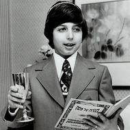 Mitchell Brown; 11; reads from the Haggadah; the ancient chronicle of Moses' struggle and final victory.