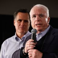 Former presidential nominee, U.S. Sen. John McCain (R-AZ) (R) announces that he is endorsing Republican presidential candidate and former Massachusetts Gov. Mitt Romney during a town hall meeting at Central High School January 4, 2012 in Manchester, New Hampshire.